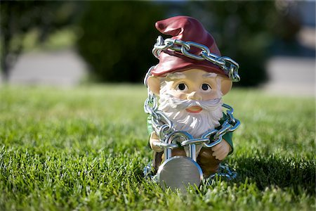 dwarf - Gnome Tied Up in Chains Stock Photo - Rights-Managed, Code: 700-03697945