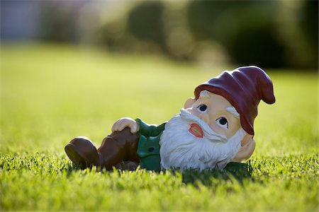 Gnome Relaxing on Lawn Stock Photo - Rights-Managed, Code: 700-03697940