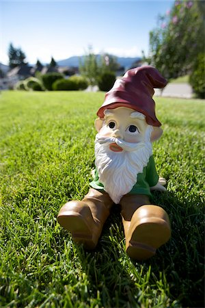 dwarf - Gnome Sitting on Lawn Stock Photo - Rights-Managed, Code: 700-03697941