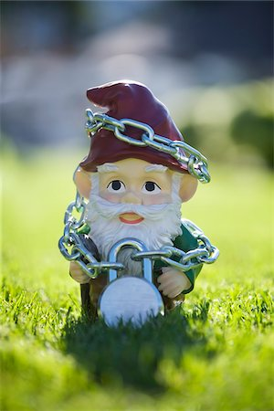 dwarf - Gnome Tied Up in Chains Stock Photo - Rights-Managed, Code: 700-03697942