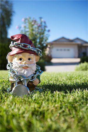 dwarf - Gnome on Lawn Tied Up in Chains, Pentiction, Okanagan Valley, British Columbia, Canada Stock Photo - Rights-Managed, Code: 700-03697943