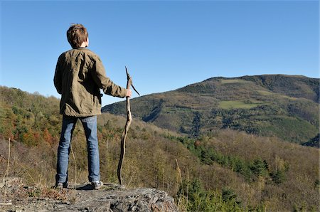 Boy with Walking Stick Observing Landscape Stock Photo - Rights-Managed, Code: 700-03698236