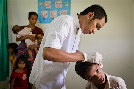 Boy being Treated for Ear Infection, Hobawawi Clinic, Sumba, Indonesia Stock Photo - Rights-Managed, Code: 700-03698322