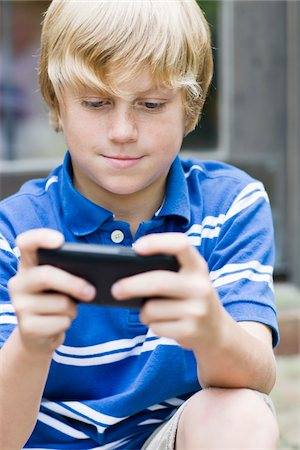 Boy with Cell Phone Stock Photo - Rights-Managed, Code: 700-03719328