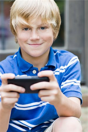 Boy with Cell Phone Stock Photo - Rights-Managed, Code: 700-03719329