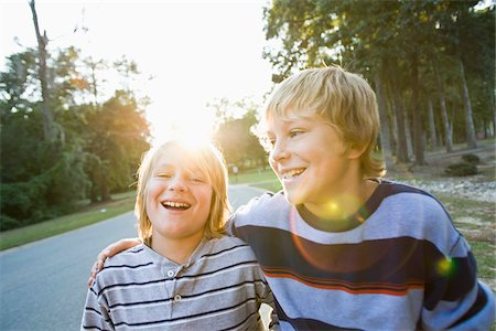 Brothers Outdoors with Arms Around Each Other Stock Photo - Rights-Managed, Code: 700-03719320