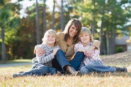 Mother Sitting with Sons on Grass Stock Photo - Rights-Managed, Code: 700-03719330