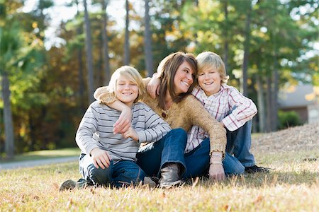 Mother Sitting with Sons on Grass Stock Photo - Rights-Managed, Code: 700-03719331