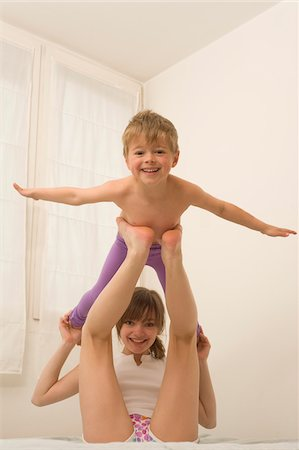 Brother and Sister Playing Airplane Stock Photo - Rights-Managed, Code: 700-03720134