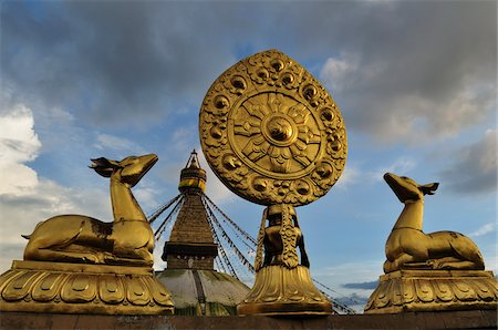 Wheel of Dharma and Stupa in Boudhanath, Bagmati Zone, Madhyamanchal, Nepal Stock Photo - Rights-Managed, Code: 700-03737496