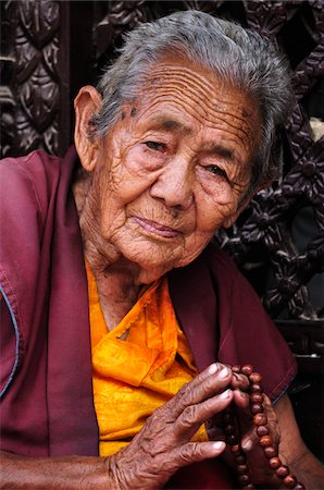 Portrait of Tibetan Woman, Boudhanath, Bagmati Zone, Madhyamanchal, Nepal Stock Photo - Rights-Managed, Code: 700-03737511