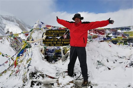 Hiker at Top of Thorung La, Annapurna Conservation Area, Gandaki Zone, Pashchimanchal, Nepal Stock Photo - Rights-Managed, Code: 700-03737550