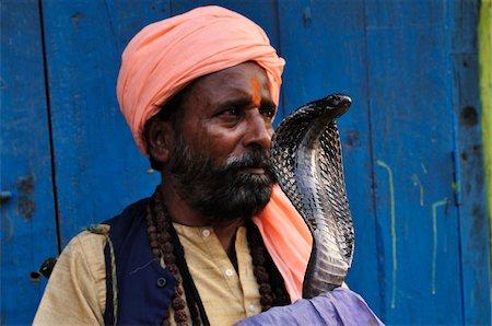Snake Charmer with Indian Cobra, Varanasi, Varanasi District, Uttar Pradesh, India Stock Photo - Rights-Managed, Code: 700-03737867