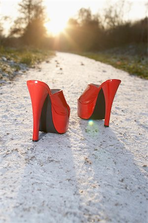 Red High Heel Shoes on Sandy Path Stock Photo - Rights-Managed, Code: 700-03738120