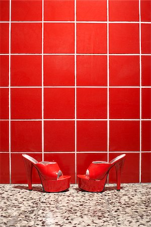 Red Shoes Against Red Tile Background Stock Photo - Rights-Managed, Code: 700-03738123