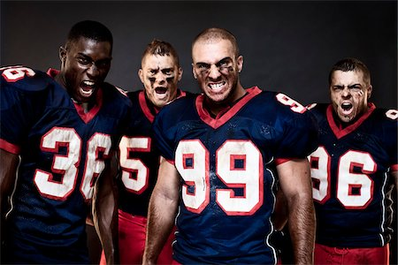 football team - Four Football Players in Studio Stock Photo - Rights-Managed, Code: 700-03738354