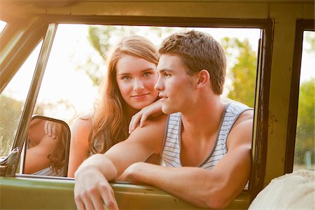 Teenage Couple Leaning Through Car Window Stock Photo - Rights-Managed, Code: 700-03738534
