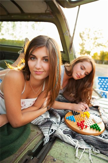 Two Teenage Girls Playing Board Game in Back of Car Stock Photo - Premium Rights-Managed, Artist: Ty Milford, Image code: 700-03738545