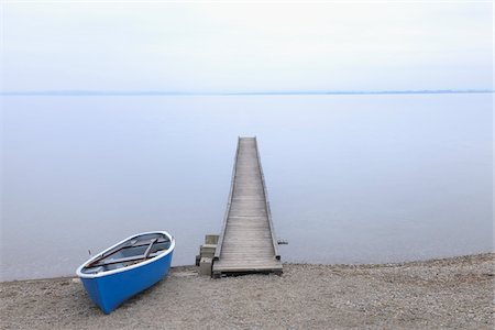 Boat and Dock, Lake Chiemsee, Bavaria, Germany Stock Photo - Rights-Managed, Code: 700-03738988