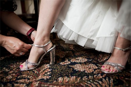 Helping Bride Buckle Shoes Stock Photo - Rights-Managed, Code: 700-03739064
