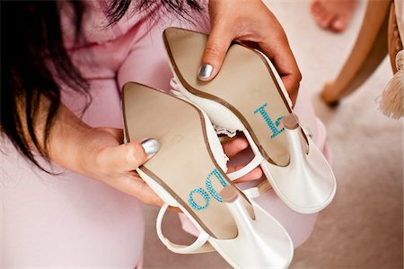 "quirky - Woman Holding Shoes with ""I Do"" on Soles Stock Photo - Rights-Managed, Code: 700-03739060"