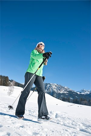 Woman Walking with Ski Poles Outdoors in Winter Stock Photo - Rights-Managed, Code: 700-03739209