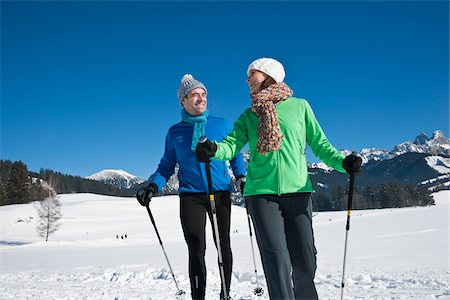 Couple Walking with Ski Poles in Winter Stock Photo - Rights-Managed, Code: 700-03739217