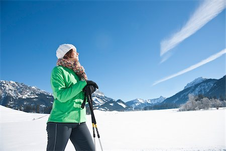 Woman Walking with Ski Poles in Winter Stock Photo - Rights-Managed, Code: 700-03739213