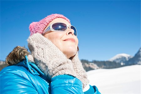 Woman Wearing Sunglasses Outdoors in Winter Stock Photo - Rights-Managed, Code: 700-03739248