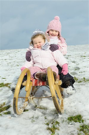 Sisters on Sled Stock Photo - Rights-Managed, Code: 700-03739258