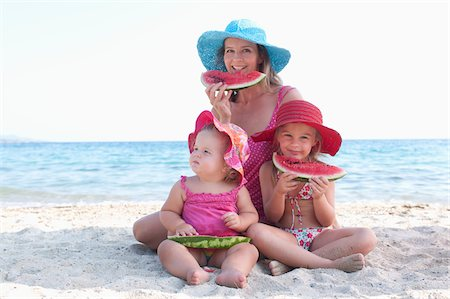 Mother with Daughers Eating Watermelon on Beach Stock Photo - Rights-Managed, Code: 700-03739268