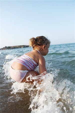 Little Girl Playing in Water at Beach Stock Photo - Rights-Managed, Code: 700-03739287