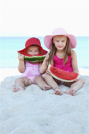Sisters Eating Watermelon on Beach Stock Photo - Rights-Managed, Code: 700-03739327