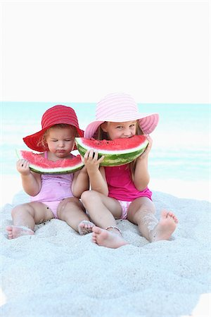 Sisters Eating Watermelon on Bridge Stock Photo - Rights-Managed, Code: 700-03739328
