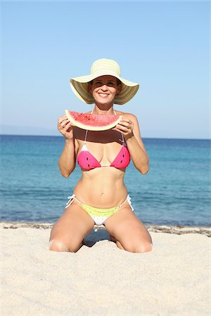 Woman with Watermelon on Beach Stock Photo - Rights-Managed, Code: 700-03739329