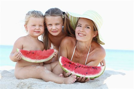 Mother and Daughters with Watermelon on Beach Stock Photo - Rights-Managed, Code: 700-03739330