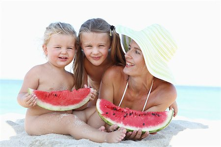 Mother and Daughters on Beach Eating Watermelon Stock Photo - Rights-Managed, Code: 700-03739331