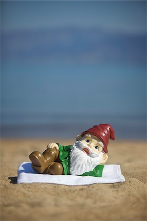 dwarf - Garden Gnome Lying on Towel on Beach Stock Photo - Rights-Managed, Code: 700-03739356