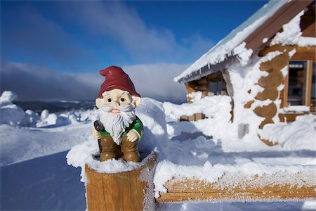 Garden Gnome at Cabin in Winter Stock Photo - Rights-Managed, Code: 700-03739360