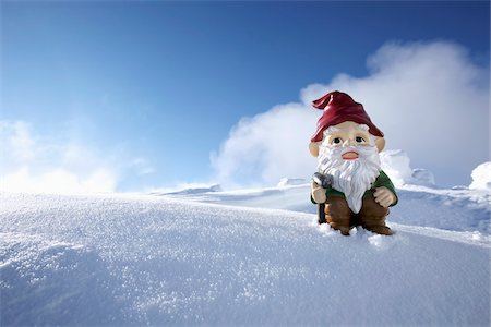 snow - Garden Gnome on Side of Snow Covered Mountain Stock Photo - Rights-Managed, Code: 700-03739363