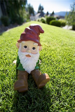 dwarf - Garden Gnome on Lawn Stock Photo - Rights-Managed, Code: 700-03739370