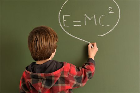 Boy Writing Equation on Chalkboard Stock Photo - Rights-Managed, Code: 700-03766831