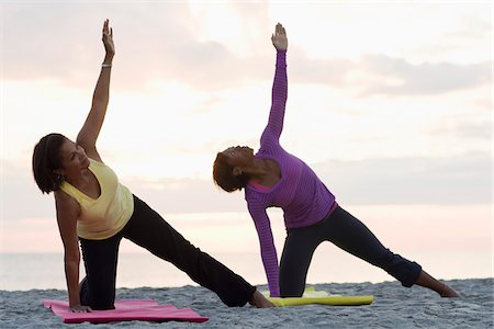 Two Women Doing Yoga on Beach Stock Photo - Rights-Managed, Code: 700-03762640