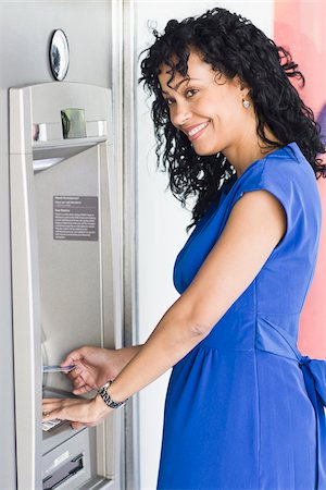 Woman Using ATM Stock Photo - Rights-Managed, Code: 700-03762695