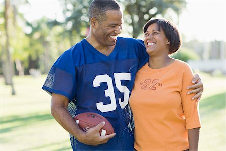Couple with Football Looking at Each Other Stock Photo - Rights-Managed, Code: 700-03762725
