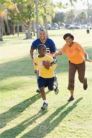 Family Playing Football Stock Photo - Rights-Managed, Code: 700-03762721