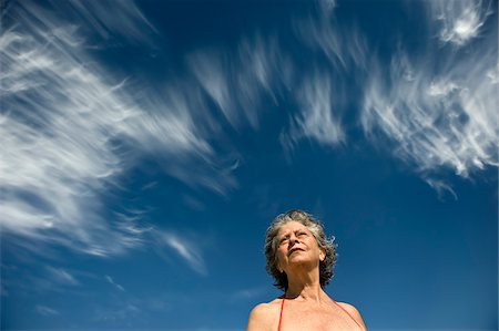 Low View of Woman Against Blue Sky Stock Photo - Rights-Managed, Code: 700-03762784