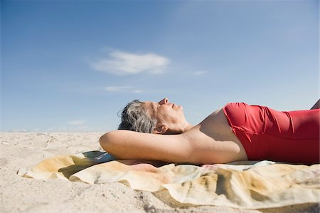 Woman Sunbathing on Beach Stock Photo - Rights-Managed, Code: 700-03762783