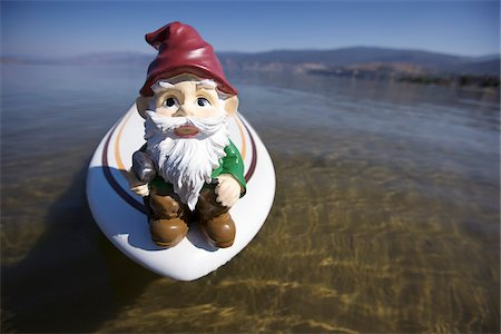 dwarf - Garden Gnome on Surfboard in Lake Stock Photo - Rights-Managed, Code: 700-03777182