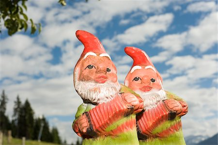 dwarf - Two Garden Gnomes Against Cloudy Blue Sky Stock Photo - Rights-Managed, Code: 700-03777747